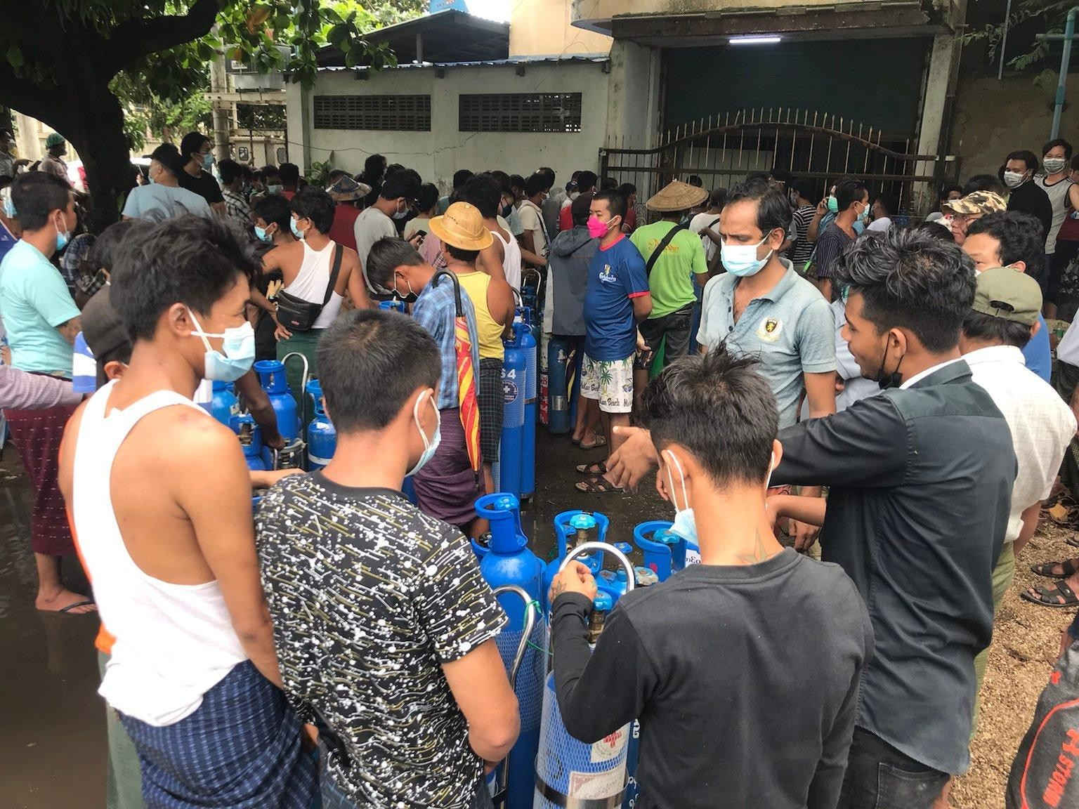Civilians are seen queuing for oxygen in Yangon's South Dagon Township on July 11. (Photo: Myanmar Now)