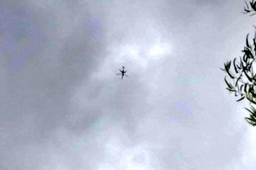 A helicopter flies over Demoso to attack on civilian resistance fighters on Monday (Supplied)